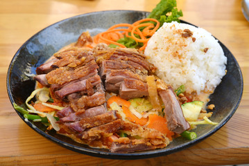 roasted duck with vegetables and rice asian style