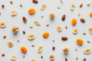 top view of tasty dried fruits and nuts isolated on white background
