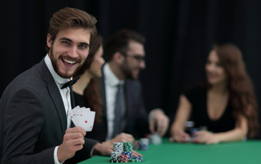 smiling business man showing four aces