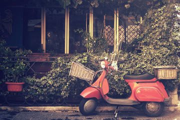 Fotorolgordijn Scooter retro scooter in italy, traditional style motorcycle with foliage background (image with vintage effect)