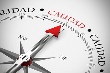 Kompass zeigt in Richtung Calidad / Qualität