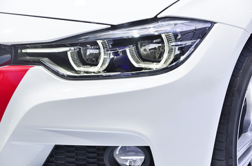 Wall Mural - Close up detail on one of the LED headlights modern car.