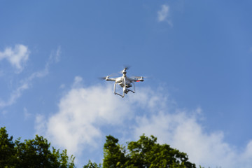 Drone flying against cloudy blue sky. place for text.