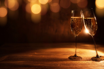 Golden christmas background with champagne
