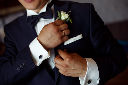 the man corrects the boutonier. the groom with a boutonier. meeting of the groom.