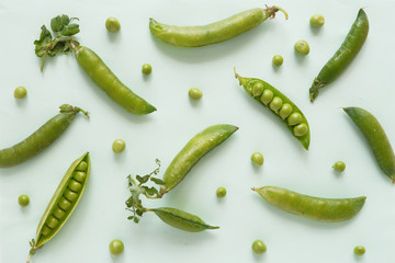 Fototapete - Pattern of fresh green peas on green background, top view, flat layout.