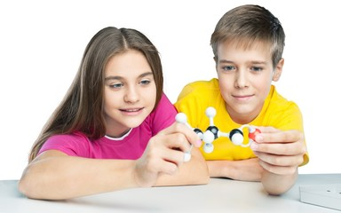 Two School Children Holding Molecular Model