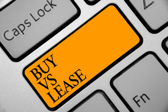 Conceptual hand writing showing Buy Vs Lease. Business photo showcasing Own something versus borrow it Advantages Disadvantages Keyboard orange key computer computing reflection document.
