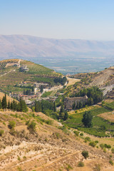 Panorama of the Bekaa Valley landscape with the Niha temples and vineyard hills, Lebanon.