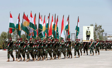 Members of the Peshmerga Zirvani commandos march during their graduation ceremony at the Tiger training camp in Erbil