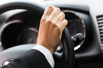 Close-up of a Hand on a Steering Wheel