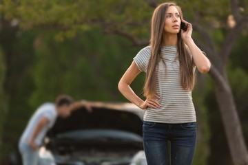 Portrait of a Woman Calling For Car Assistance