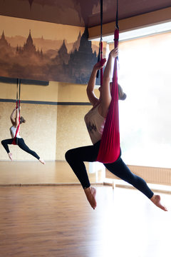 The girl is engaged in air yoga