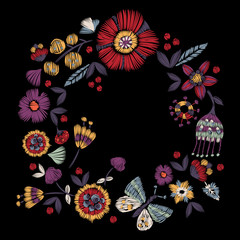 Embroidery round pattern with simplified flowers and butterfly. Vector embroidered floral patch for print and fabric design.