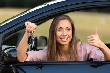 Portrait of a Smiling Woman Looking out of the Window of her Car