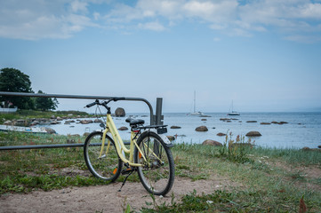 Bicycle parked along the stoned coast of Baltic sea. Kasmu, village of captains, Estonia. Copy space.