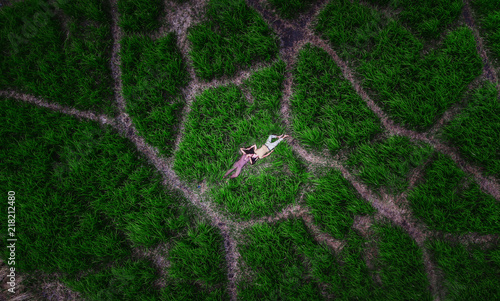 grass field from above. Above The Romantic Couple On Green Grass Field From Above