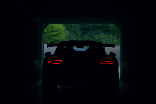 Back view of supercar in tunnel
