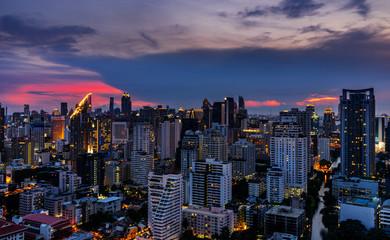 scenic of urban cityscape on sunset with twilight skyline