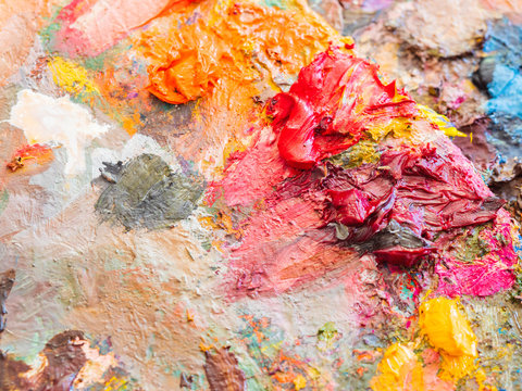 Artists multicolored oil paints on wooden palette or canvas. Close up abstract background. Art concept.