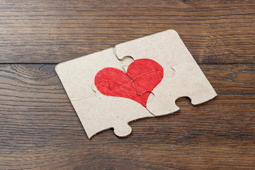 The parts of the puzzle form the heart. The concept of family, joint cooperation, friendship, communication.