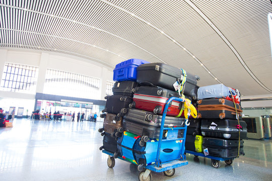 Many Colorful Luggage stack over bags before loading
