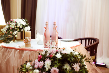 Sparkling glassware stands on long table prepared for wedding dinner.