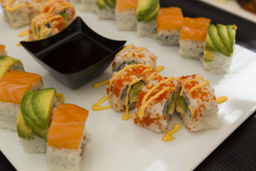 set of various sushi with soya sauce