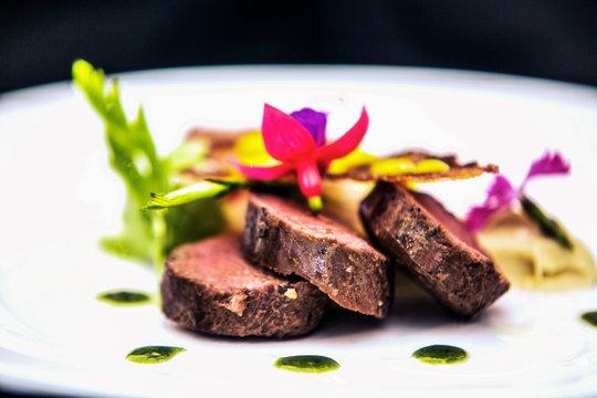 Modern food stylist decorating meal for presentation in restaurant. Closeup of food stylish. Restaurant serving