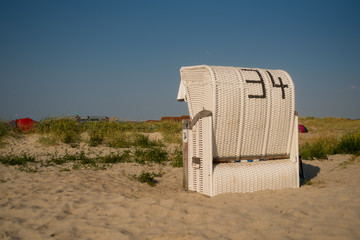 Beach Chair on sand beach at Norddeich, Frisia, North Germany on sunny day