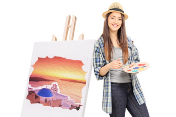 Female painter leaning on an easel