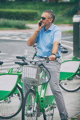 Man riding a city bicycle in formal style