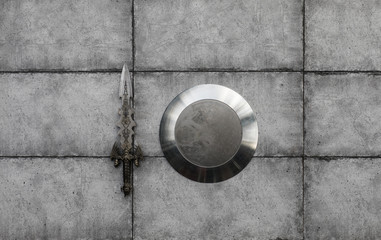 shield and sword isolated on a dark background