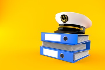 Captain's hat on stack of ring binders