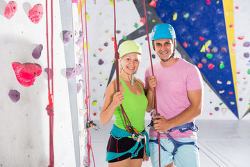 Two confident athletes at bouldering gym