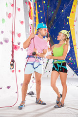 Couple of climbers dressed in rock climbing outfit training