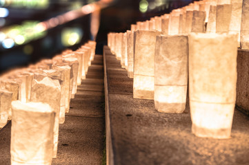 Handmade japanese rice paper lanterns illuminating the steps of the Zojoji temple near the Tokyo Tower during Tanabata Day on July 7th.