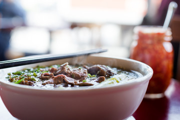 A steaming hot bowl of beef pho tai.