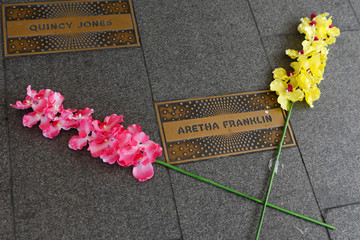 Flowers are placed by the name of singer Aretha Franklin at a makeshift memorial outside the Apollo Theater in Manhattan, New York