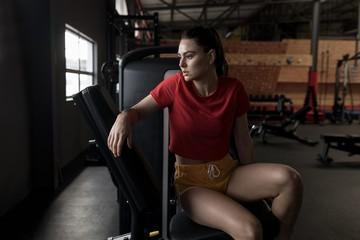 Woman relaxing in fitness studio