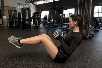 Woman doing oblique exercise in fitness studio