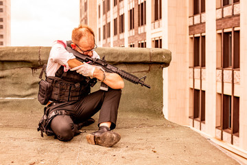 man took aim with the pistol. Action Movie Style. Close up