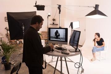 Male photographer holding camera