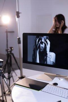 Female model posing on computer screen