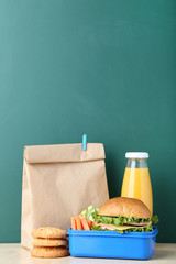 School lunch with paper bag on chalkboard background