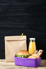 School lunch with paper bag on blackboard background