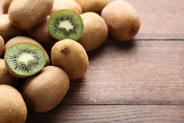 Kiwi fruits on brown wooden table
