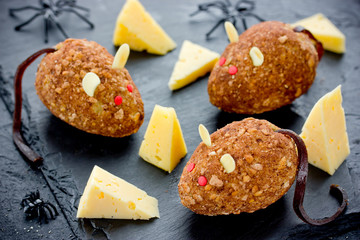 Mice cakes - funny and spooky Halloween dessert idea for kids, edible mouse cookies with red eyes and almonds ears, cute rat cakes
