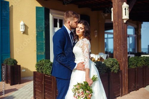 d4f999a7c96 Beautiful Bride and Groom enjoy each other. happy romantic young couple  celebrating their marriage. Sexy kissing stylish couple of lovers close up  portrait. ...