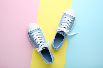 Pair of blue sneakers on colorful background